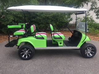 Lime Green EZGO Lifted Trolley  Lime Green/White/Pink seats, white top, new (2018) batteries, high speed code, LED lights, Backlash (23x10x14) tires, mirror, state of charge meter, cup holders & flip windshield