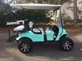 2015 Sea Foam EZGO Lifted Cart ——- In Stock  White seats, white long top, new 2019 batteries 48vt (6-8), high speed code, mirror, flip windshield, state of charge meter, LED lights & Backlash (23x10x14) tires (cooler, cups & koozie not included)