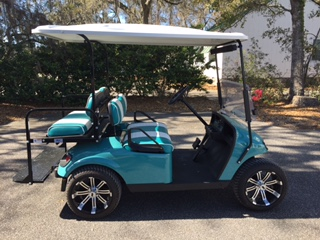 Emerald EZGO Cart  Emerald/white seats, white extended top, new 2018 batteries, mirror, flip windshield, Lo Pro tires, high speed code & LED lights