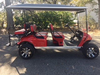 Red EZGO Lifted Trolley  Red/black seats, black top, new 2018 batteries (6-8v), high speed code, LED lights, Backlash (23x10x14) tires, state of charge meter, mirror and flip windshield