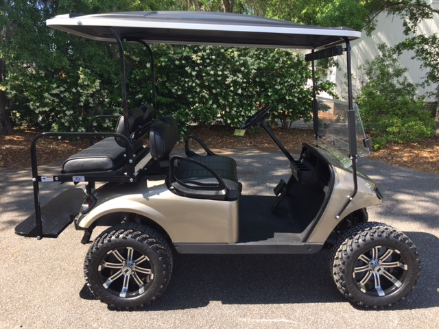 Almond (Pewter) Lifted EZGO Cart  Black seats, black extended top, new 2018 (6-8vt) batteries, high speed code, LED lights, Backlash 23x10x14 tires, mirror, and flip windshield