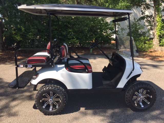 2014 White EZGO Lifted Cart  Maroon, black and white seats, black extended top, new 2018 batteries (6-8vt), high speed code, LED lights, Backlash (23x10x14) tires, mirror, rear cup holders, flip windshield, and state of charge meter