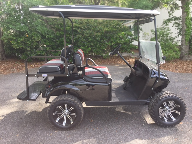 Black EZGO Lifted Cart  Black, Maroon and gray seats, black extended top, new 2018 batteries (6-8vt), high speed code, LED lights, Backlash (23x10x14) tires, mirror, flip windshield and state of charge meter