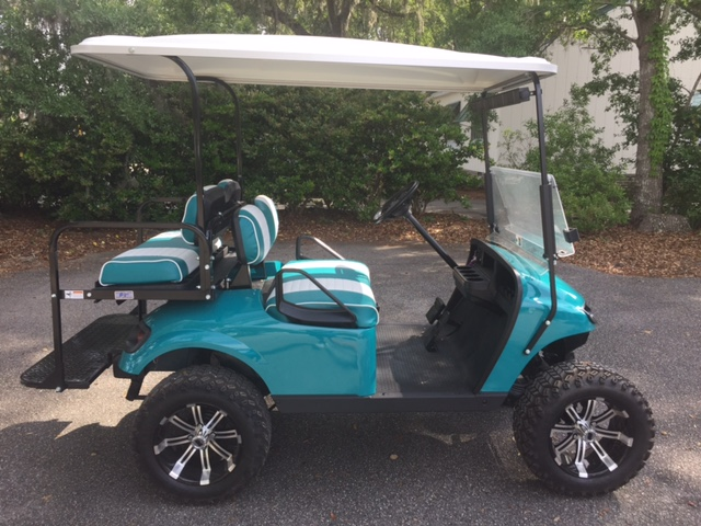 Teal EZGO Lifted Cart  Teal/white seats, white extended top, new 2018 batteries, high speed code, LED lights, Backlash (23x10x14) tires, mirror & flip windshield