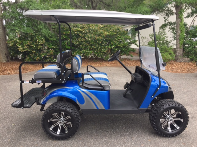2015 Viper Blue Swirl EZGO Lifted Cart — In Stock  Charcoal Blue & white seats, charcoal extended top, new 2019 batteries 48vt (6-8), high speed code, LED lights, Backlash (23x10x14) tires, mirror & flip windshield