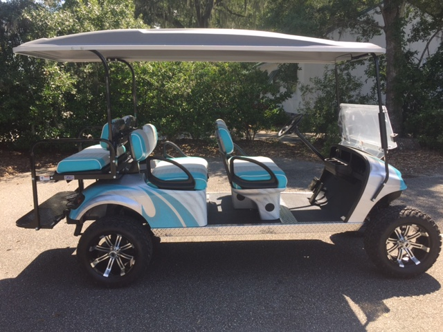 2015 Aqua Swirl EZGO Lifted Trolley — In Stock  Aqua/white/gray seats, gray top, new 2019 batteries 48vt (6-8), high speed code, LED lights, Backlash (23x10x14) tires, state of charge meter, mirror, and flip windshield