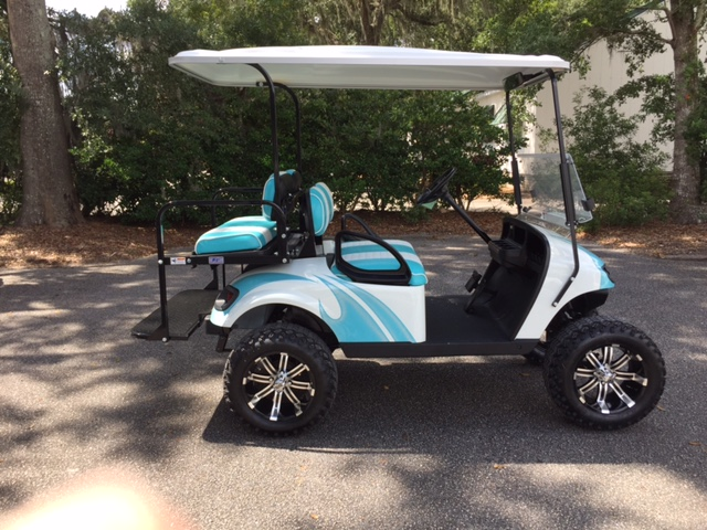 2015 White Swirl EZGO Lifted Cart ——- In Stock  Aqua/white seats, white extended top, new 2019 batteries 48vt (6-8), high speed code, LED lights, Backlash (23x10x14) tires, state of charge meter, mirror & flip windshield