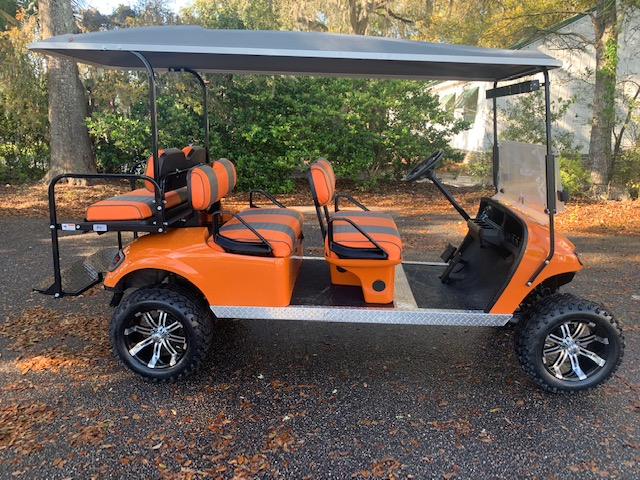 Orange EZGO Lifted Trolley  Orange/charcoal seats, gray top, new batteries, high speed code, LED lights, Backlash (23x10x14) tires, state of charge meter, mirror & flip windshield