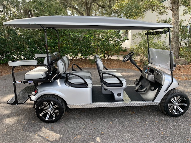 2015 Silver EZGO Lowdown Trolley  Gray/charcoal seats, gray top, new batteries 48vt (6-8), mirror, flip windshield, high speed code, state of charge meter, rear cup holders, silver dash, signal light kit w/ horn, Lo Pro tires and LED lights