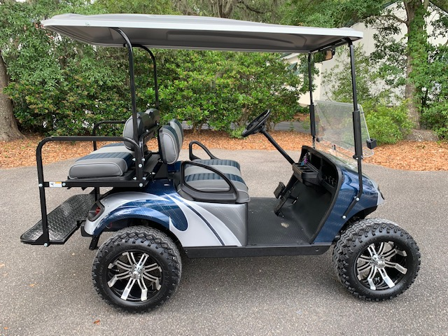 2015 Navy Swirl Lifted EZGO Cart ——— In Stock  Navy/charcoal & smoke seats, charcoal top, new 2019 batteries 48vt (6-8), mirror, flip windshield, high speed code, Backlash (23x10x14) tires and LED lights