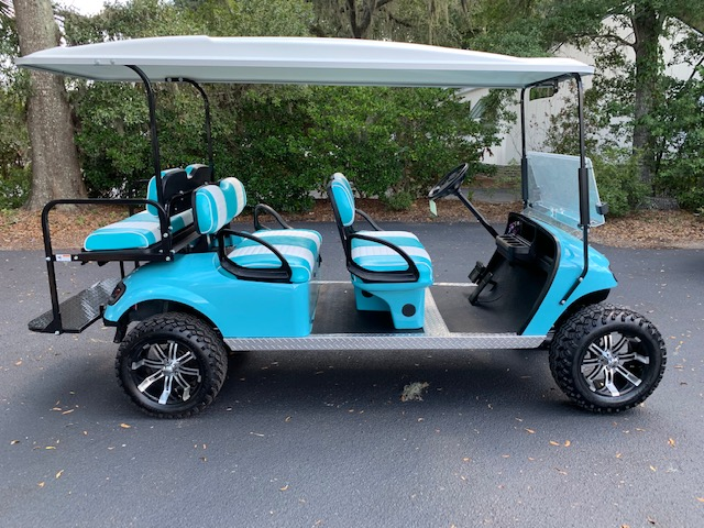 2016 Aqua EZGO Lifted Trolley ———— In Stock  Aqua/white seats, white top, new 2019 (6-8vt) batteries, high speed code, LED lights, Backlash (23x10x14) tires, state of charge meter, mirror, and flip windshield