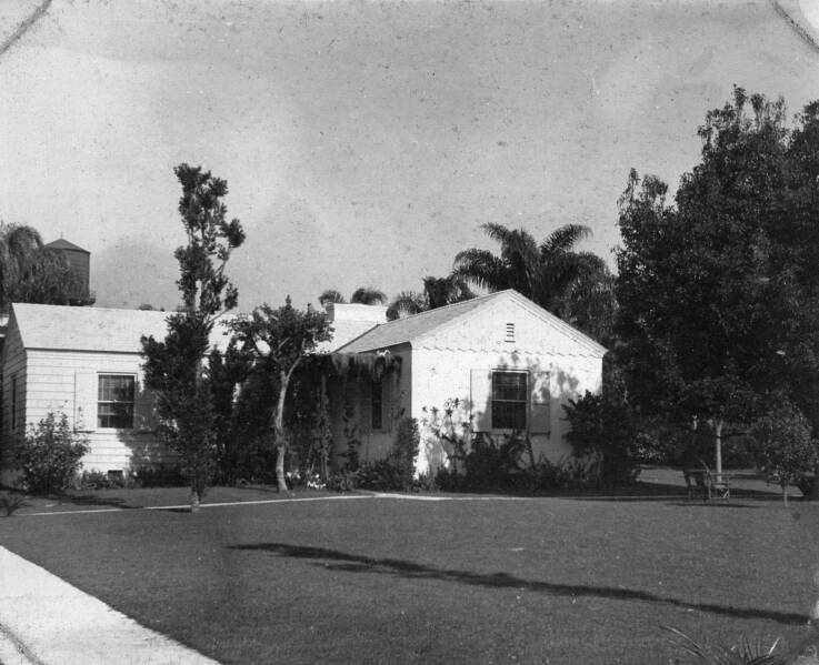 The Chauncey Cottage at Amoret in 1939. Note the old wooden water tower in the background. The water tower was replaced in 1962 with the current metal one.