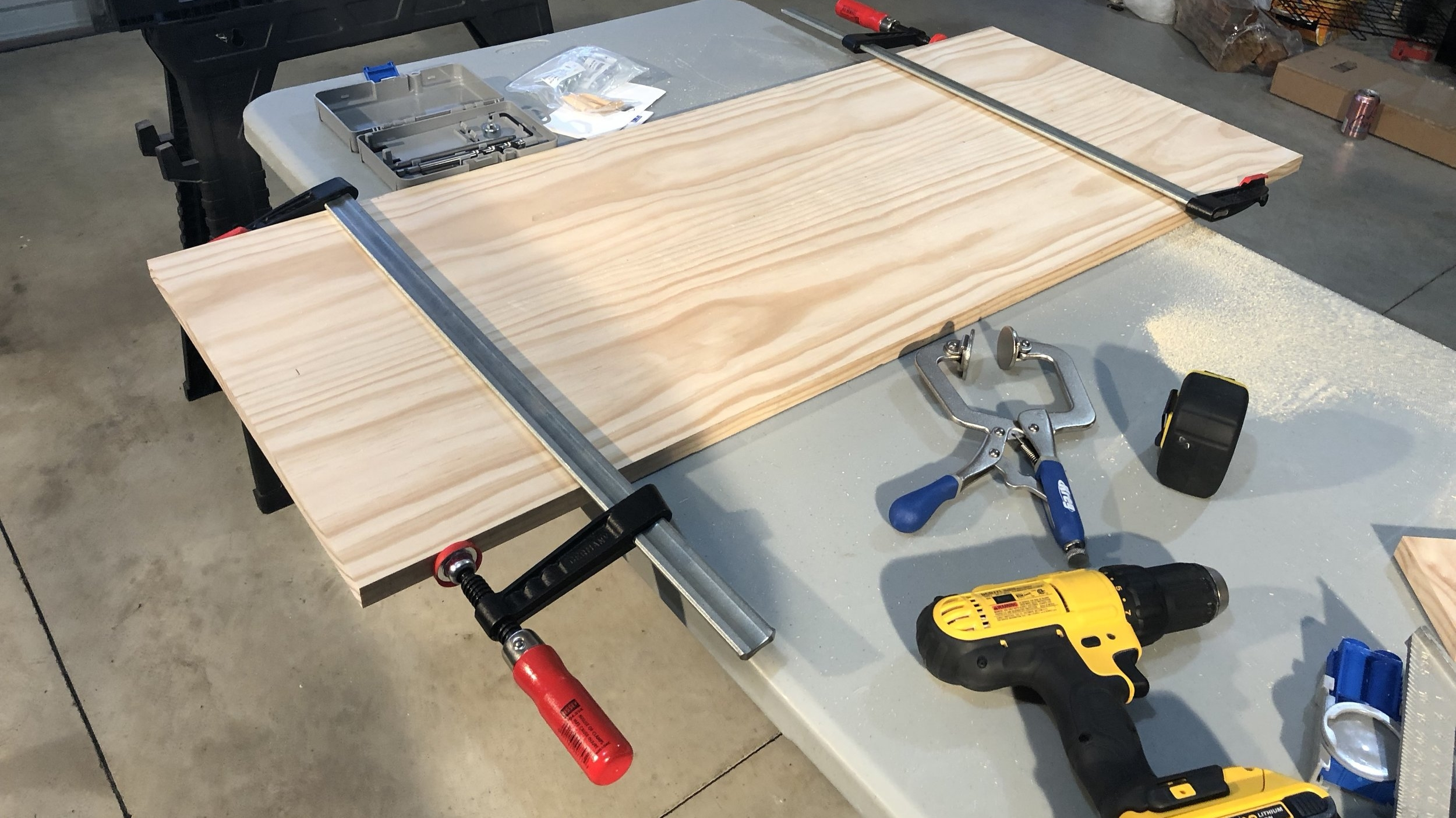 The Base - We started by measuring our dresser top, we then cut a pine board into two lengths the same as the width of our dresser.
