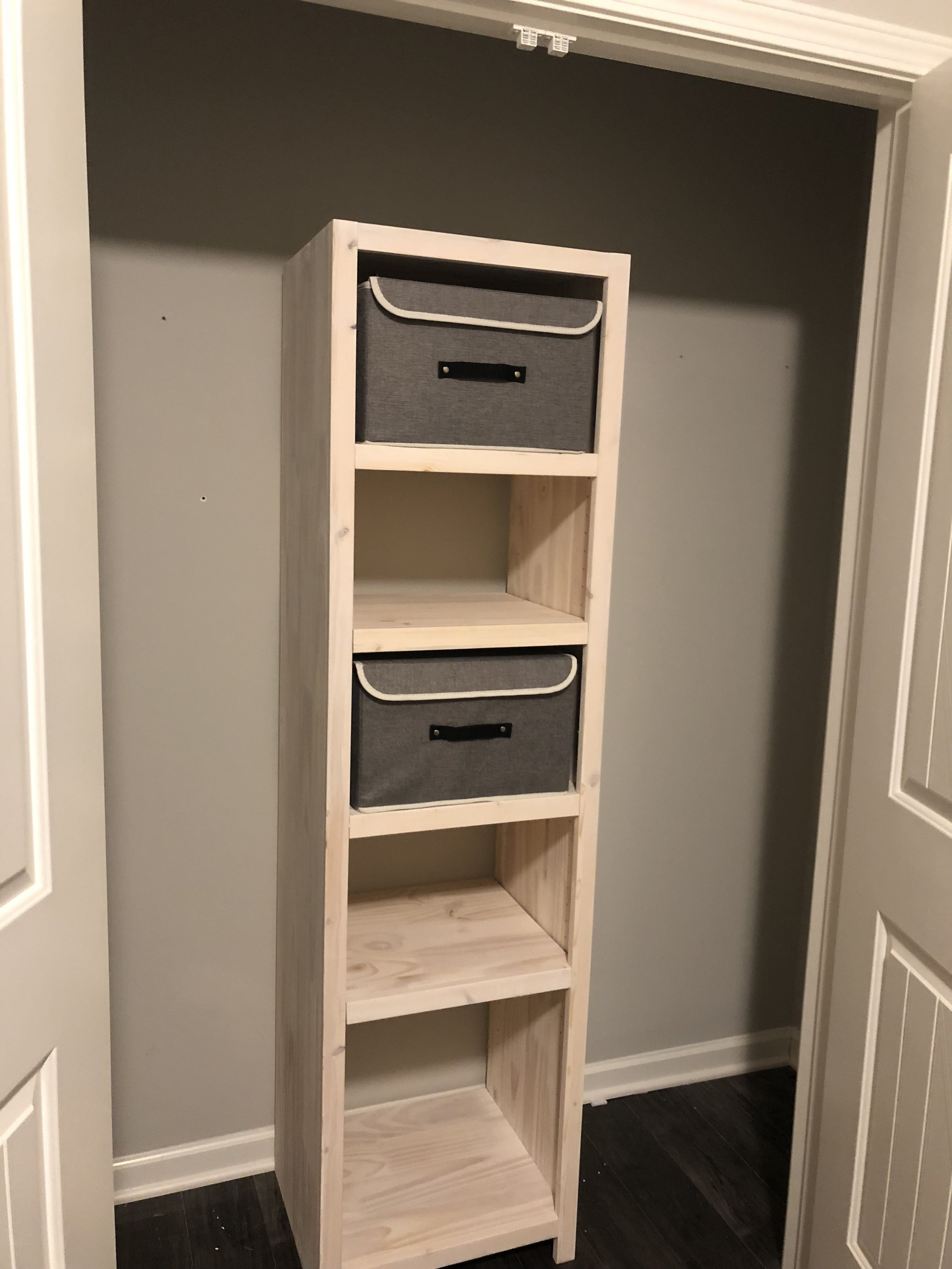 We couldn't resist. - With the shelf unit mounted, we placed the remaining shelves into position and adjusted things to fit the fabric storage we had chosen.