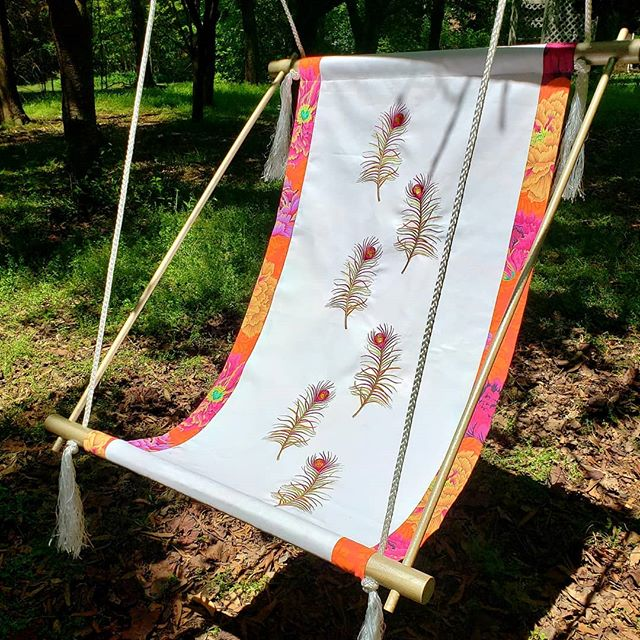 Find your place in the shade, swinging in a sling chair as the afternoon drifts by... Embroidered peacock feathers and chair sling created using a Baby Lock Machine  @BabyLockSewing  Hardware from @loweshomeimprovement  #dandelionrosedesign  #babylockusa  #loweshomeimprovement  #rustoleumpaint #pellon #madeira #embroidery #sewing #homeinprovement  #ilovesewing #machineembroidery #sew #babylocksewing