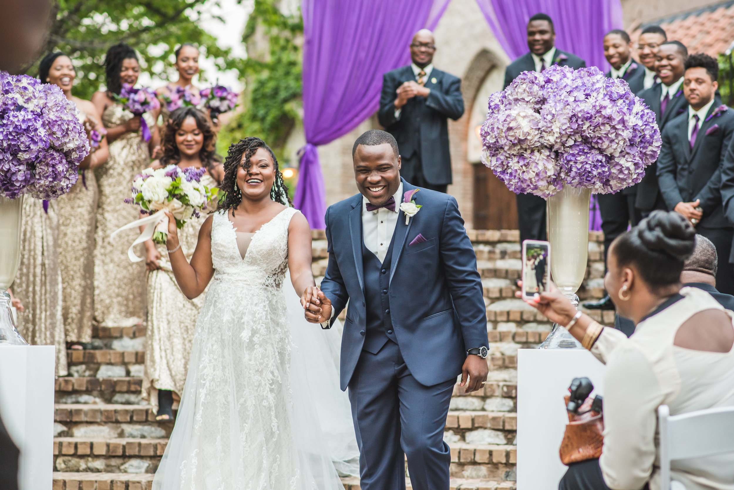 black couple jumping the broom