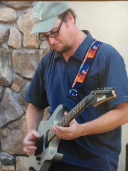 My son, Pat, performing at the local deli one year before he died.