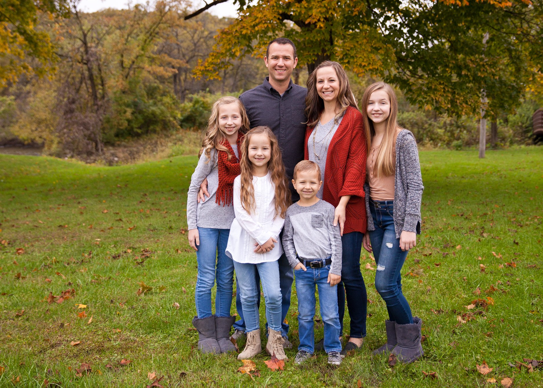 Bryce Roskens , wife Amber, and family