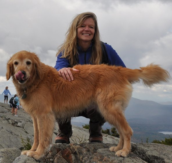 Kimberly and her beloved dog Tessa on the peak of Mountain Kearsarge (South) in New Hampshire.