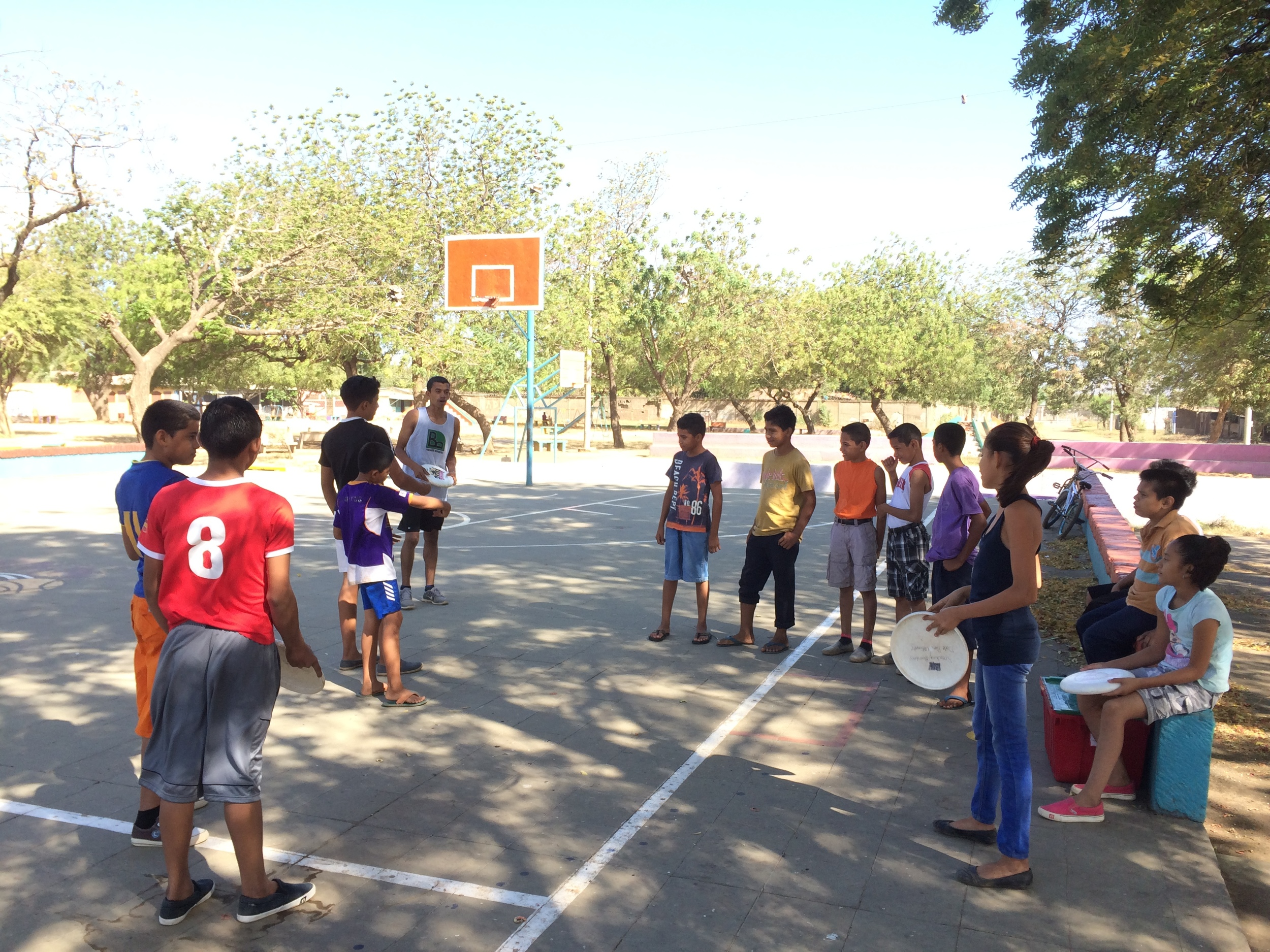 The kids in Ciudad Sandino listening to Zeke give a lesson on throwing.