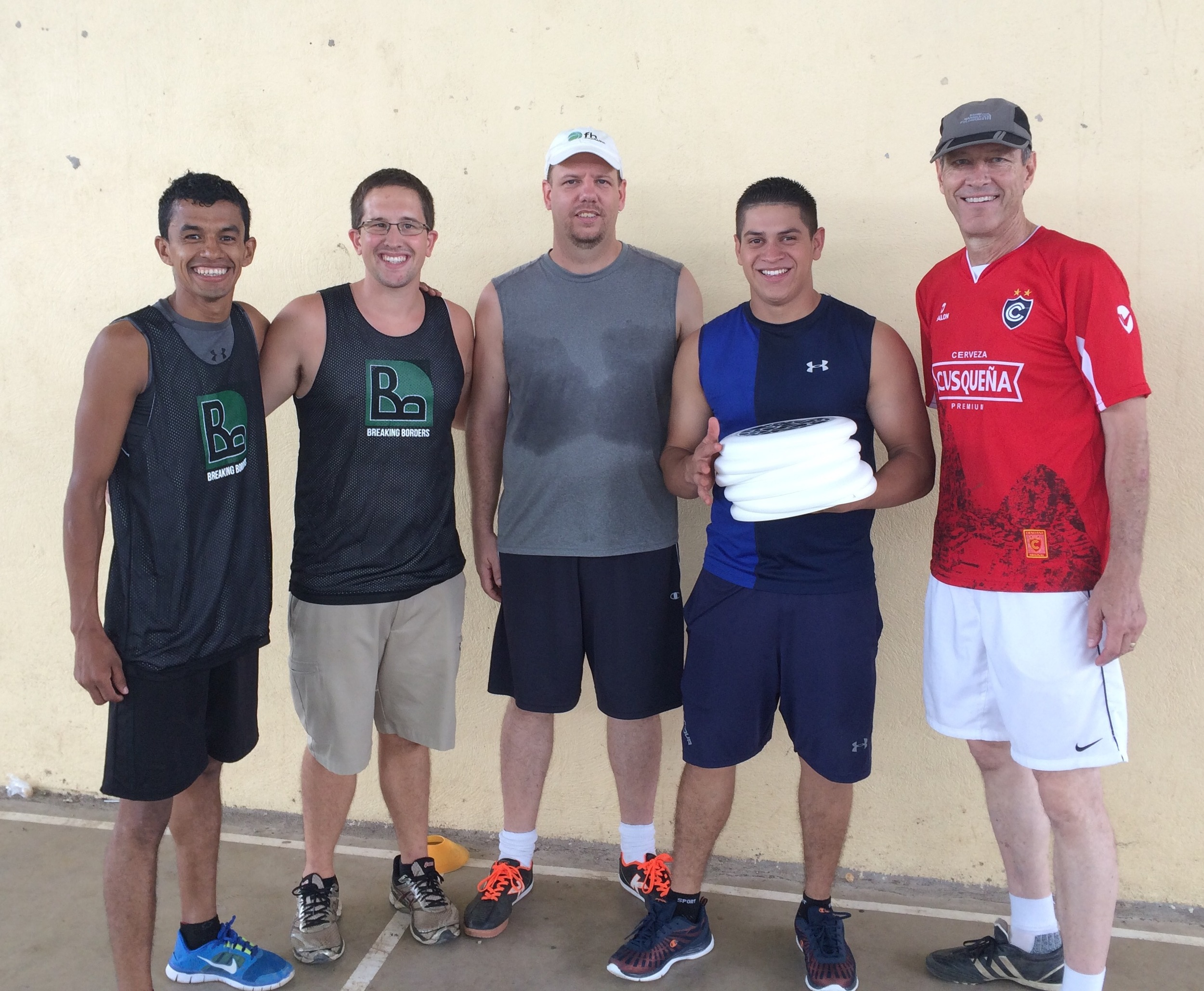 BB Staff presenting discs for the new program to NCA Matagalpa P.E. Teacher Otoniel Martinez, and Directors Greg Kynast and Nathan Sandhal,