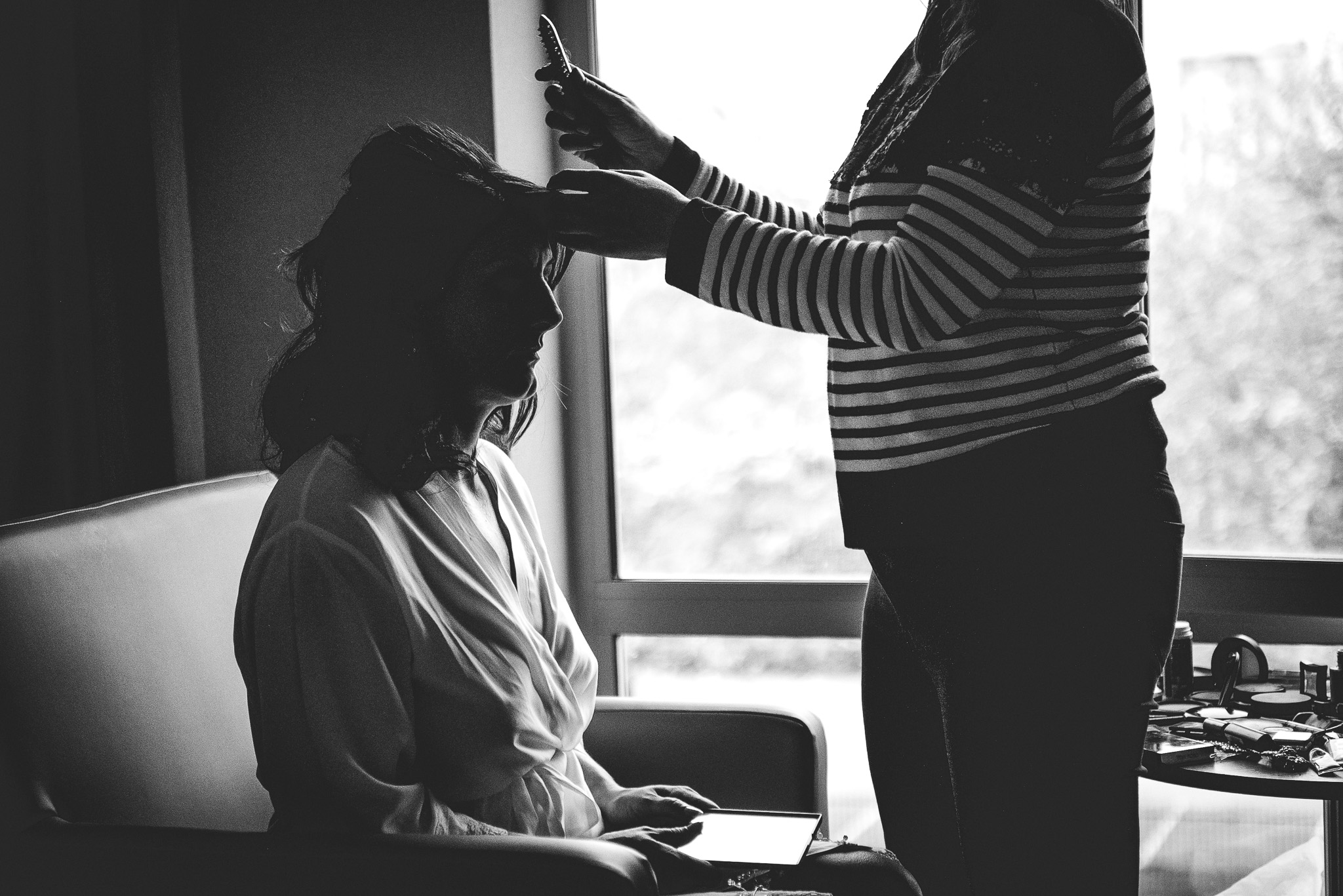 Final touches to the bride's hair