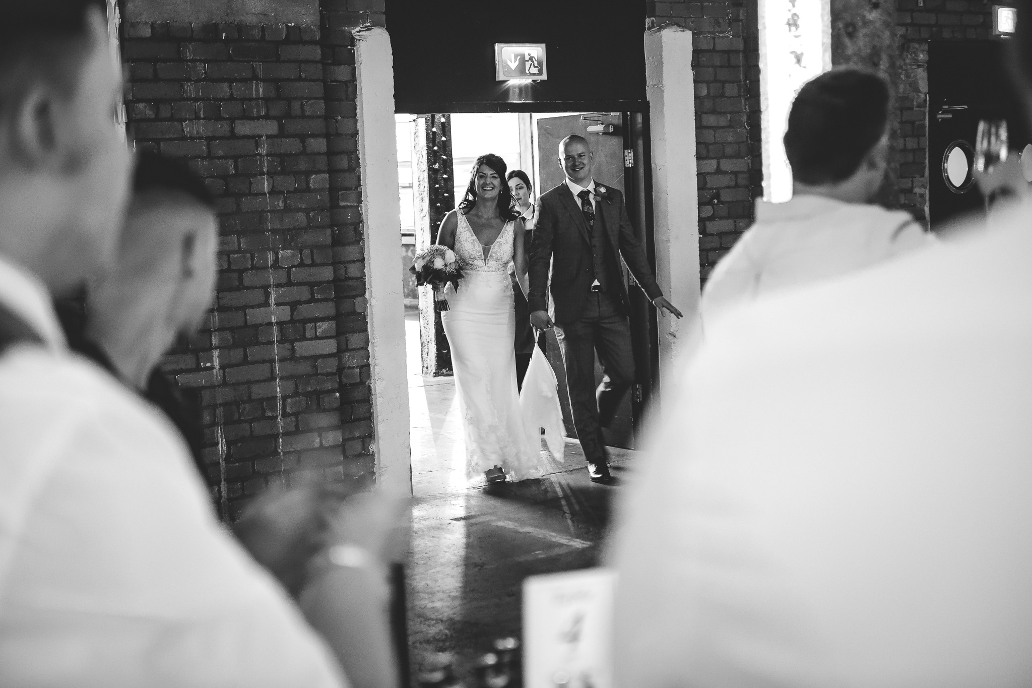 The bride and groom are welcomed to machester wedding venue, Victoria Warehouse