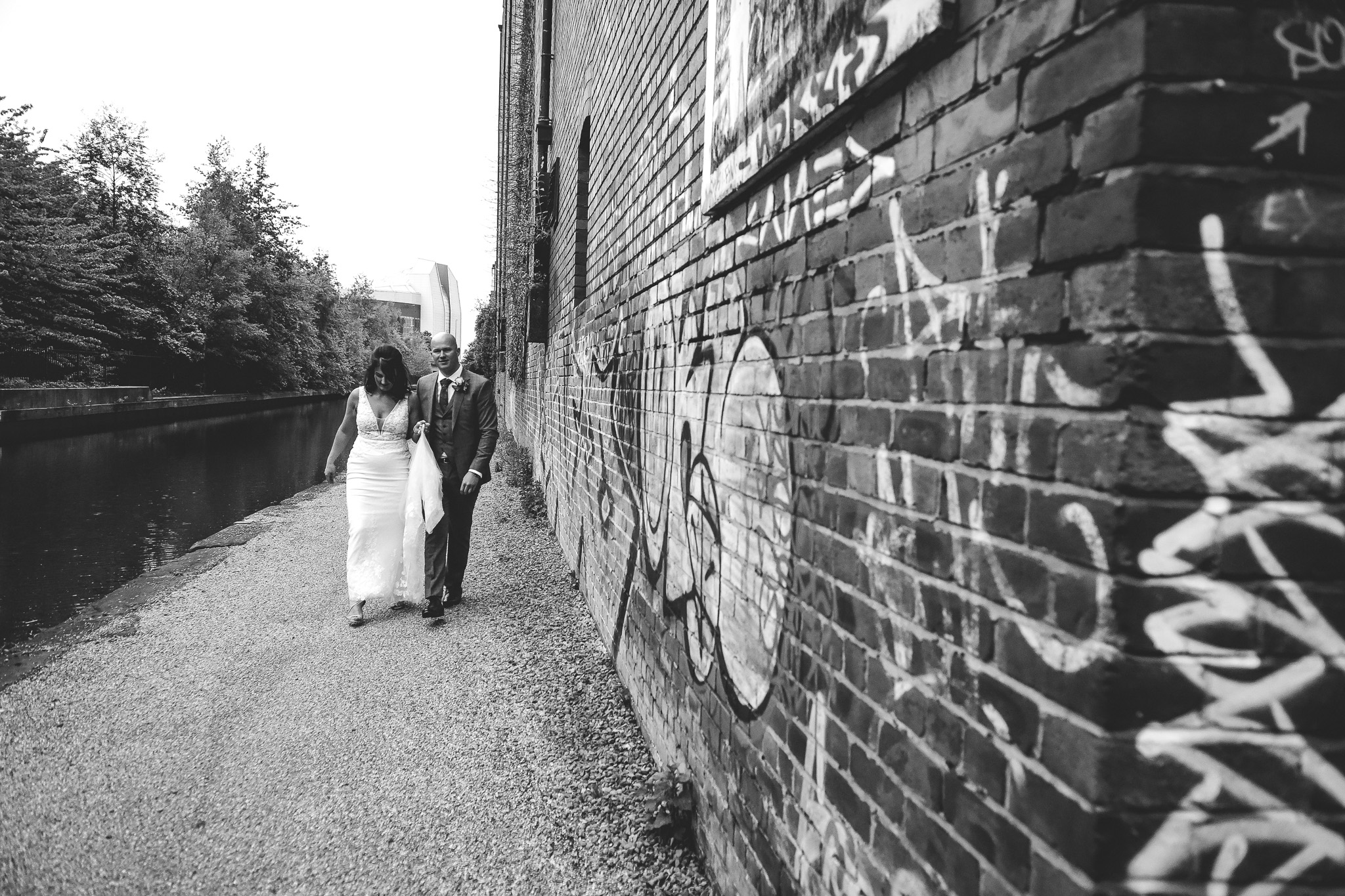 Urban wedding photograph of bride and groom next to Victoria Warehouse