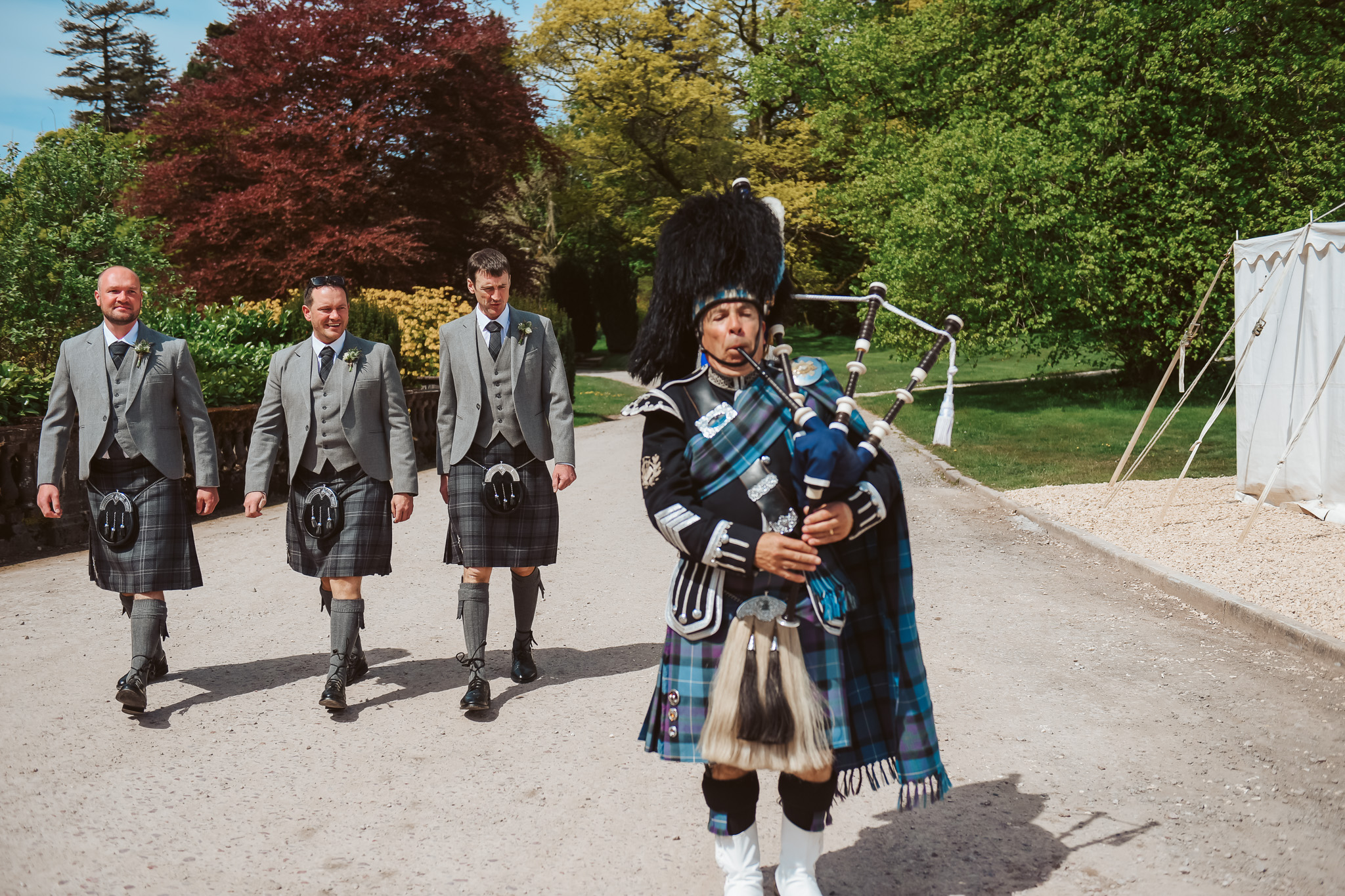 Groomsmen with a Scottish piper
