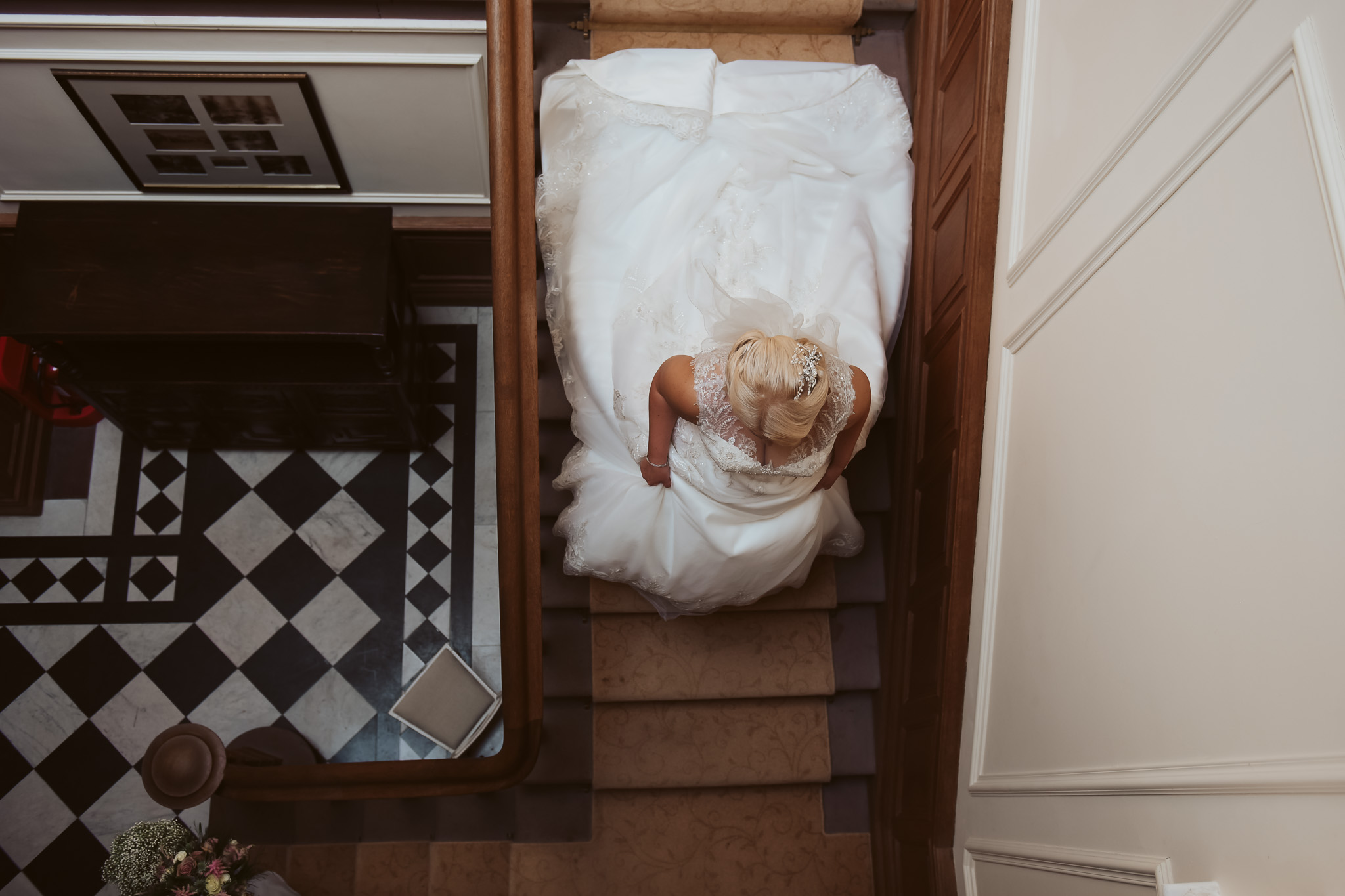 Bride making her way down the grand staircase