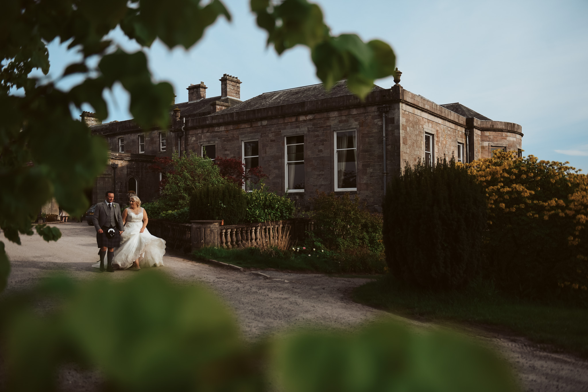 Brid e and groom going for a walk the the Palladian mansion grounds