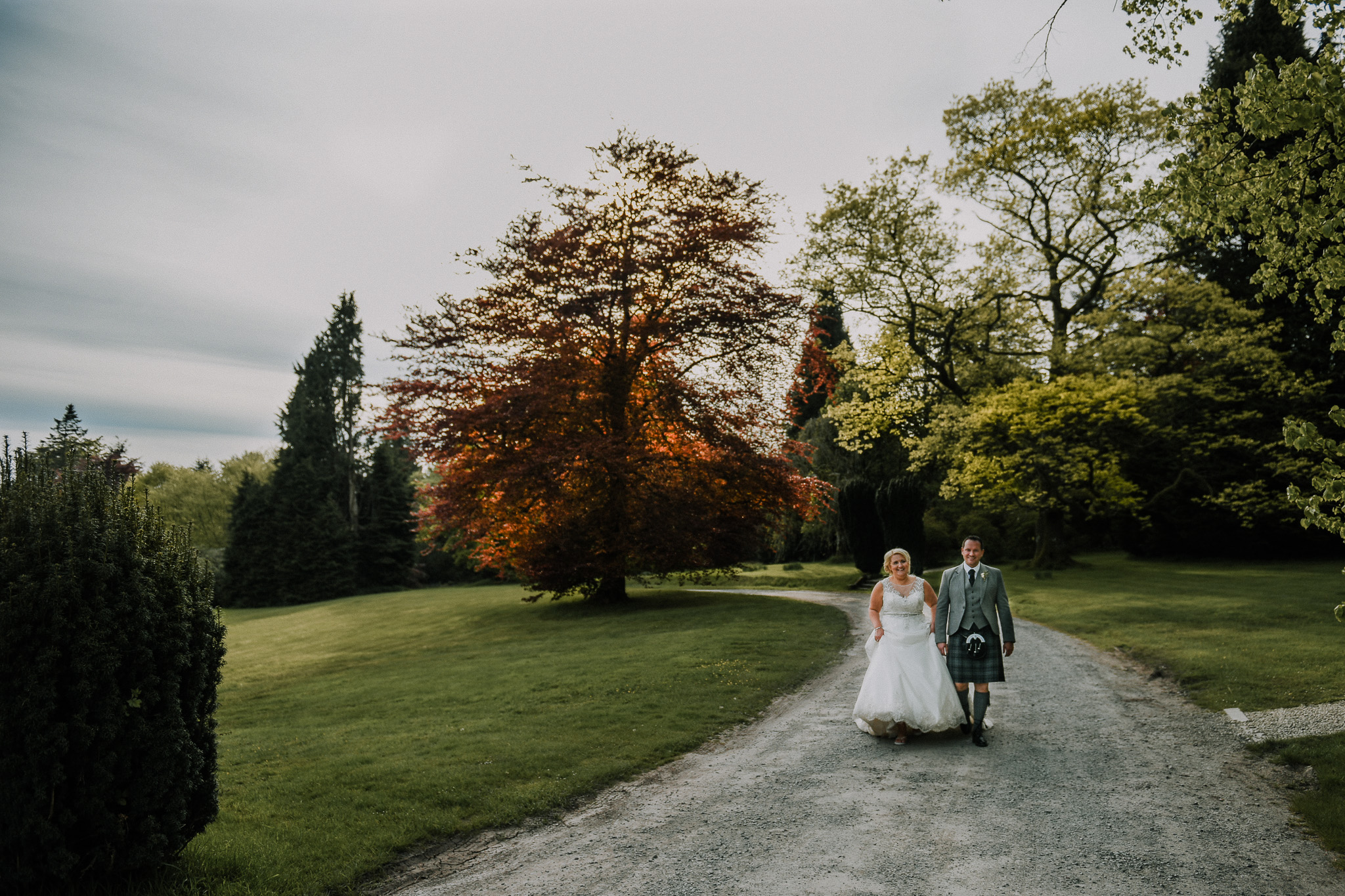 Beautiful couple in the mansion grounds