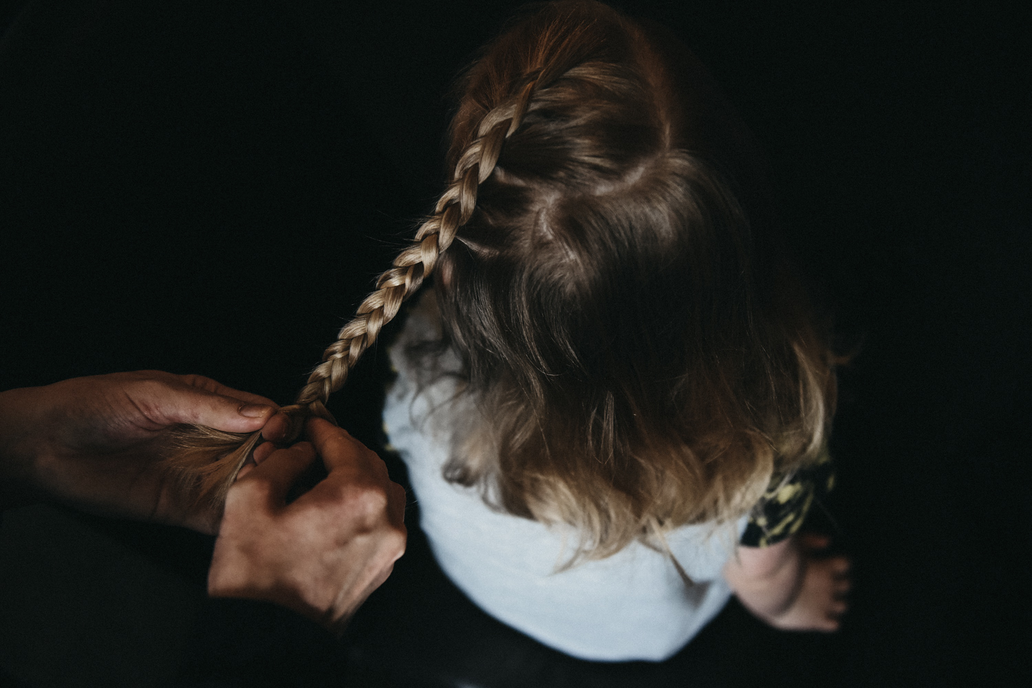 Flower girl having her hair braided