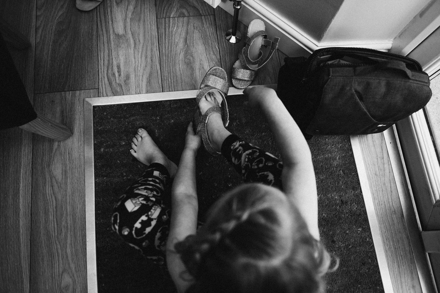 Flower girl trying on her shoes