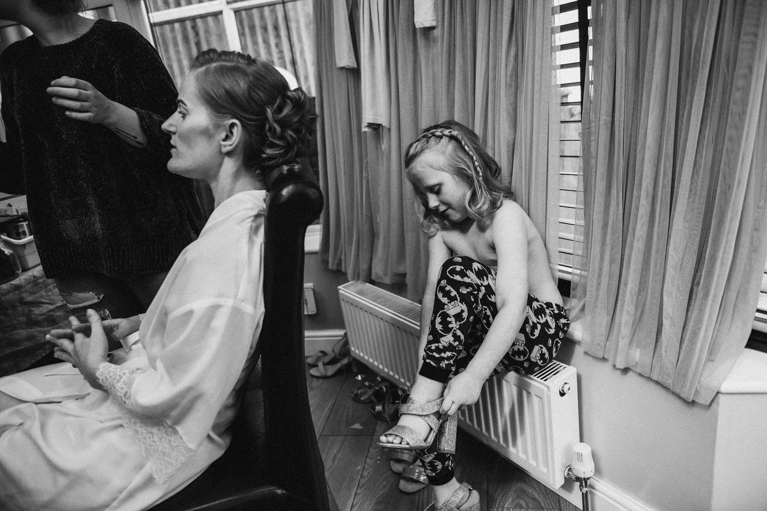 Flower girl and bride getting ready