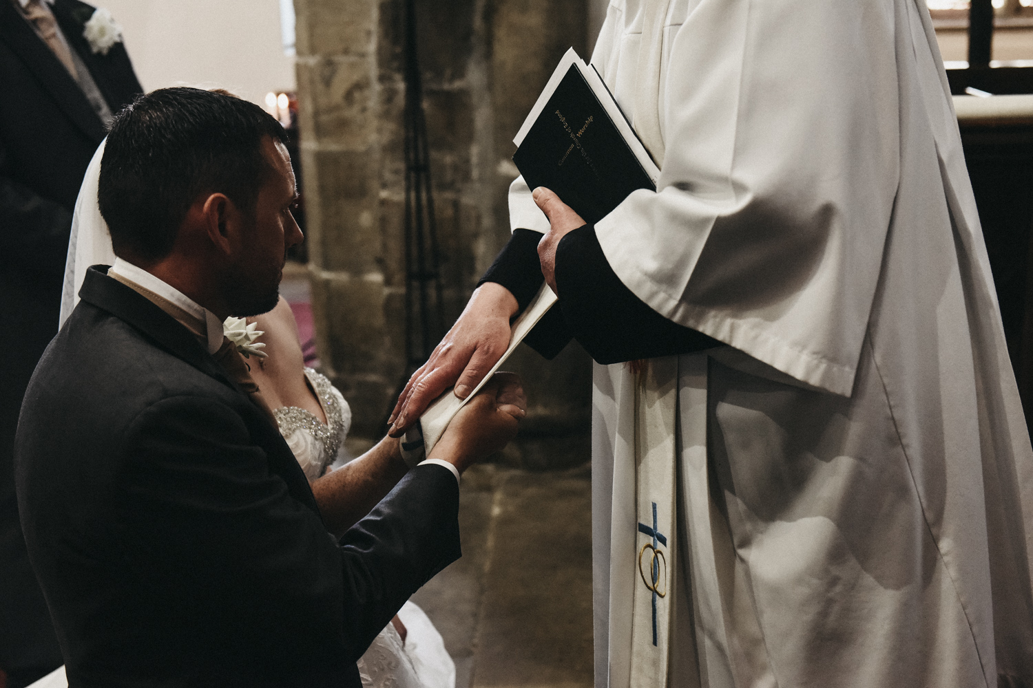 Vicar blessing the married couple