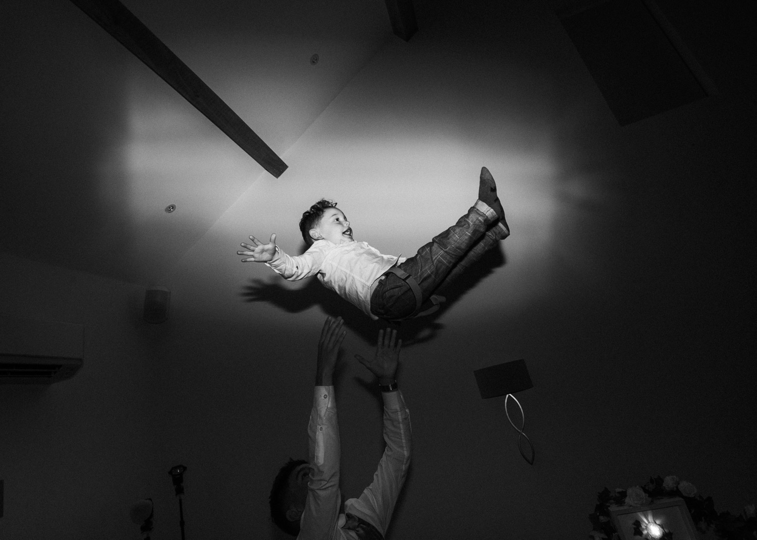 boy being thrown into the air