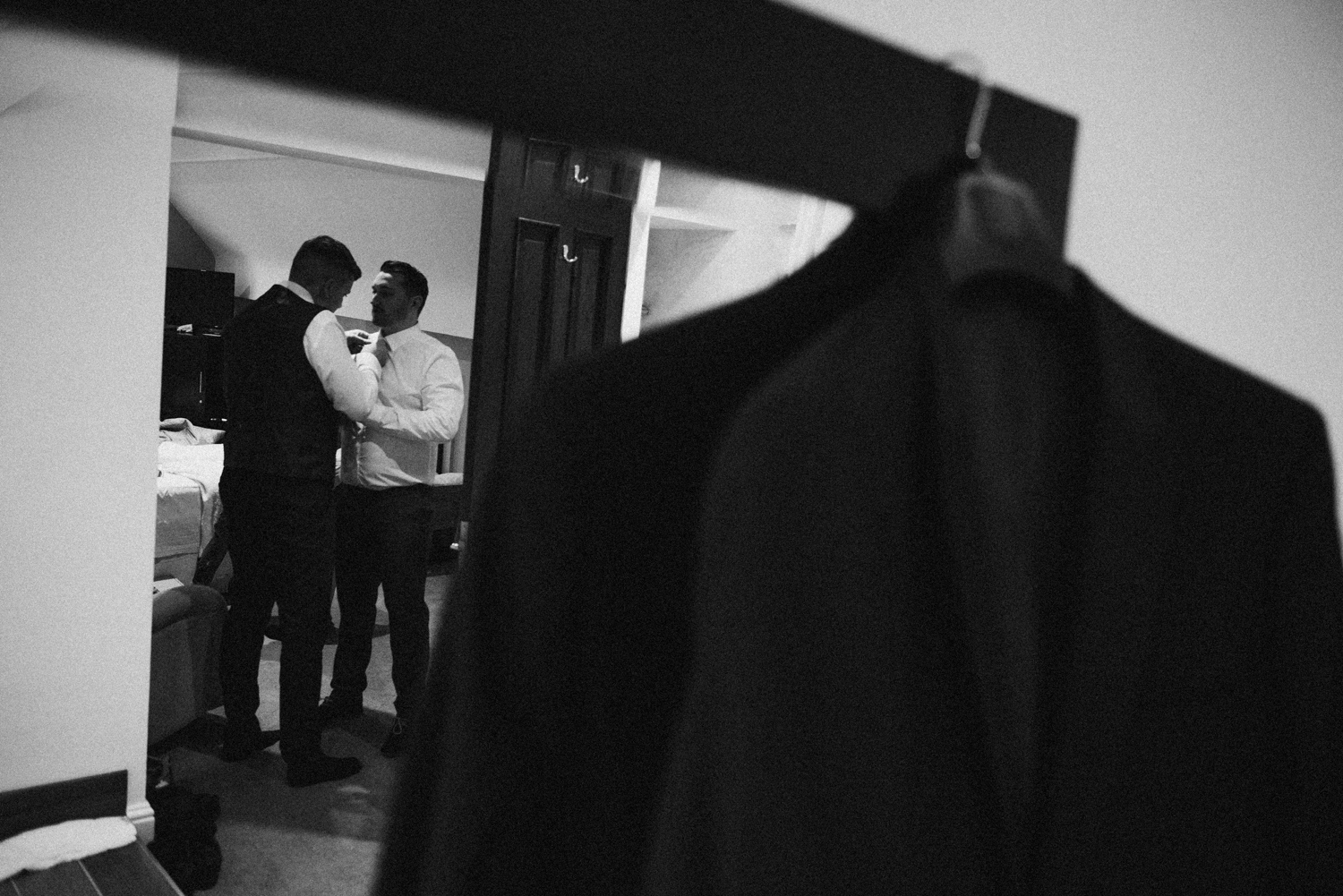 Groom helping the best man to get ready