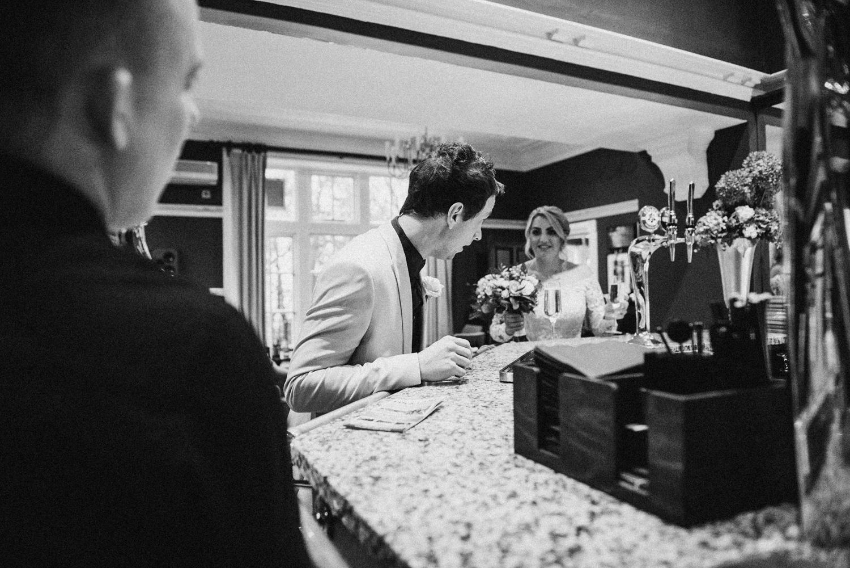 bride and groom grabbing a drink
