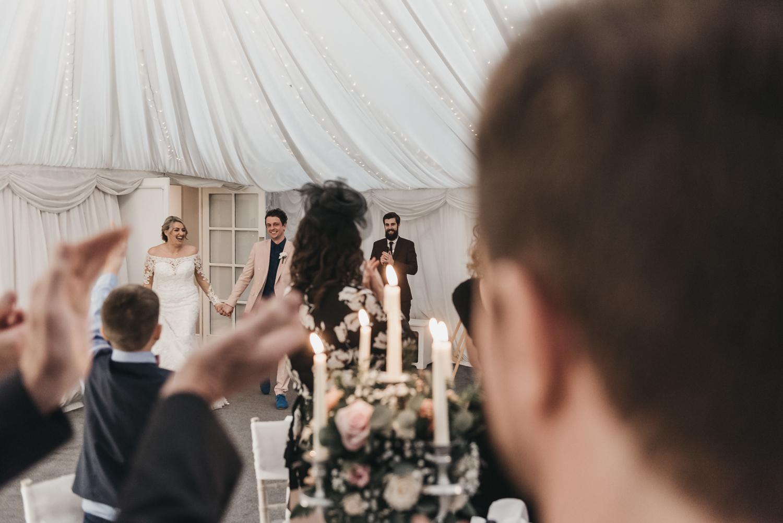 Wedding guests applaunding