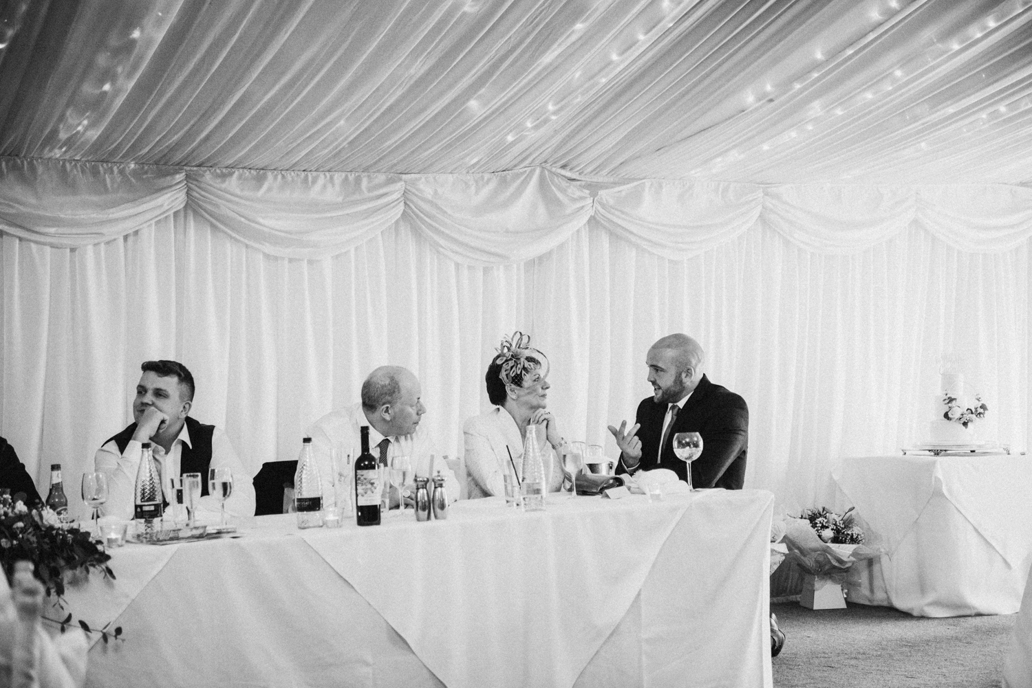 guests chatting to mother of the groom