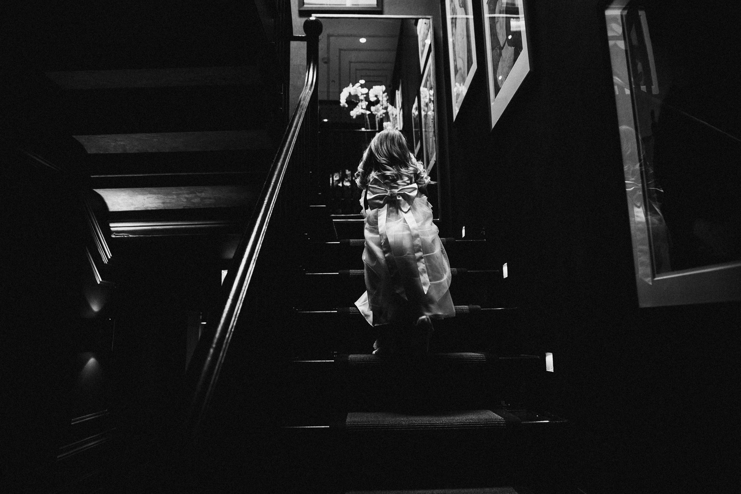 Flower girl climbing the stairs at manor house huddersfield
