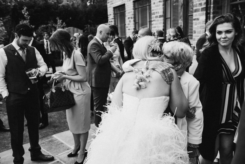Bride hugging elderly reletive