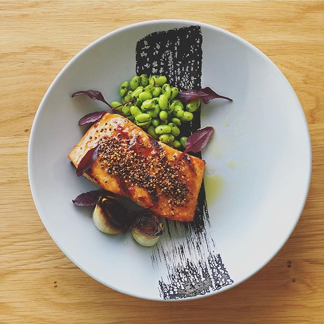 Have you seen our winter menu changes? .. Salmon fillet w/ Charred Leek, Edamame Verde and  Squid Ink. 🌱