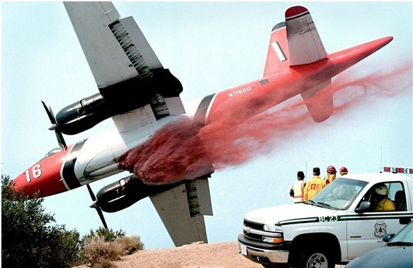 Plane dropping foam (Image via wildforestfires.com)