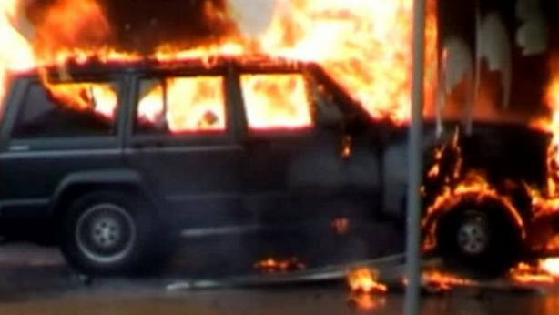 A Jeep Cherokee loaded with petrol cans and propane gas tanks driven into the doors at Glasgow passenger terminal in 2007. Image courtesy of the  BBC