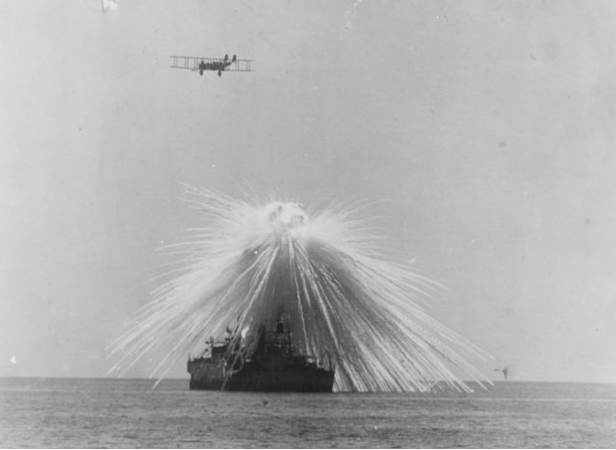 Air-burst of a white phosphorus bomb over the USS Alabama during a test exercise conducted by General Billy Mitchell, September 1921. Image courtesy of  War History Online