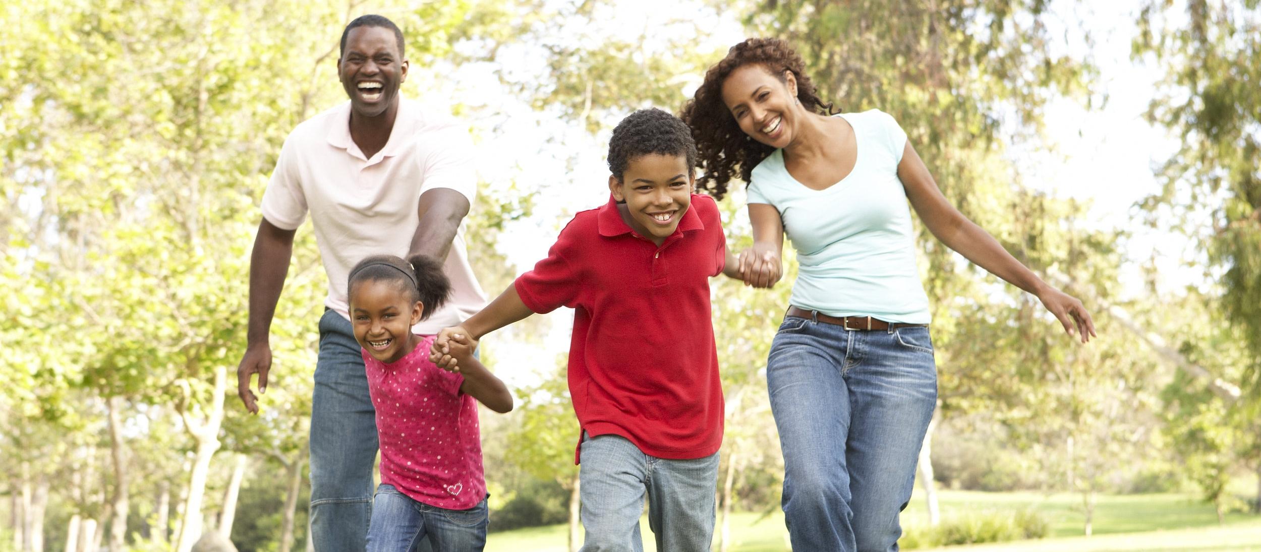 bigstock-Family-Enjoying-Walk-In-Park-13909580.jpg