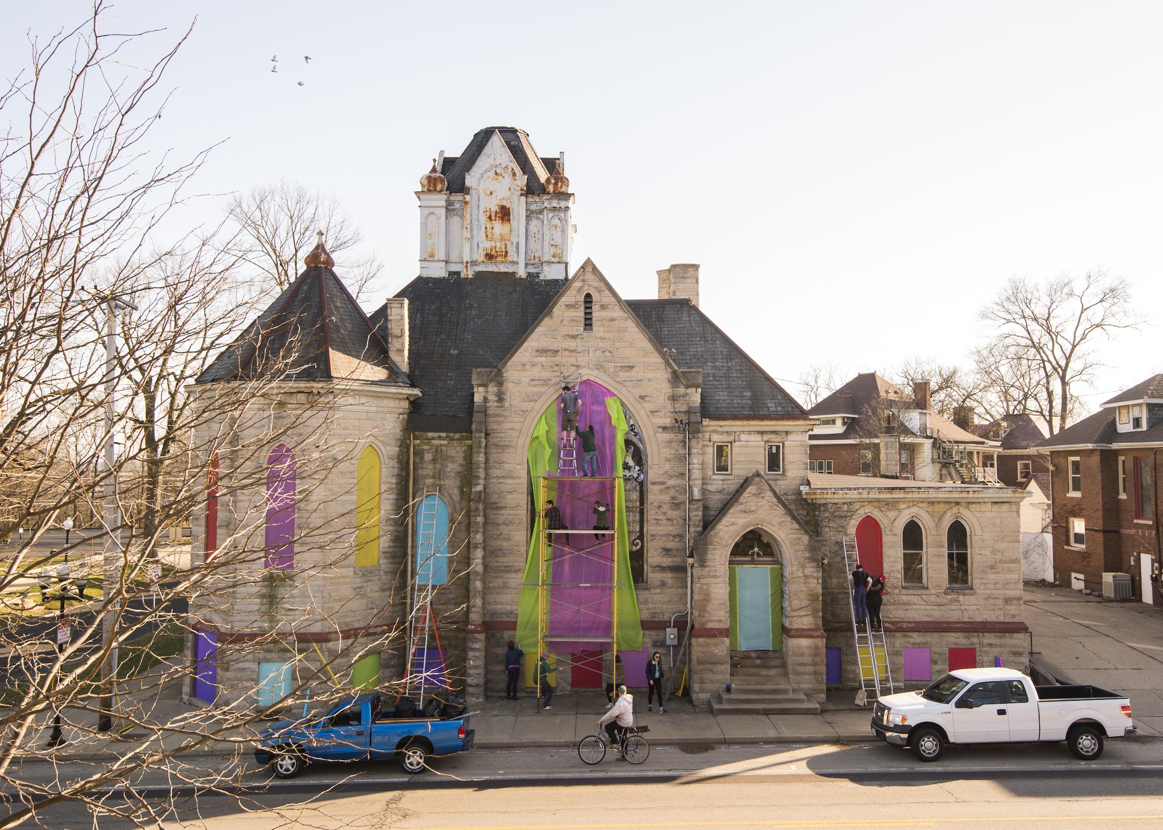 Yaku coloring the windows of the church.jpg