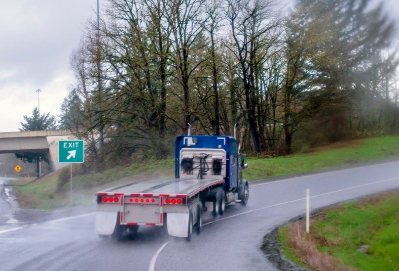 Many exit ramps are designed with curves or cloverleafs, so drivers of commercial vehicles must adjust their speed accordingly to avoid losing control or rolling over.